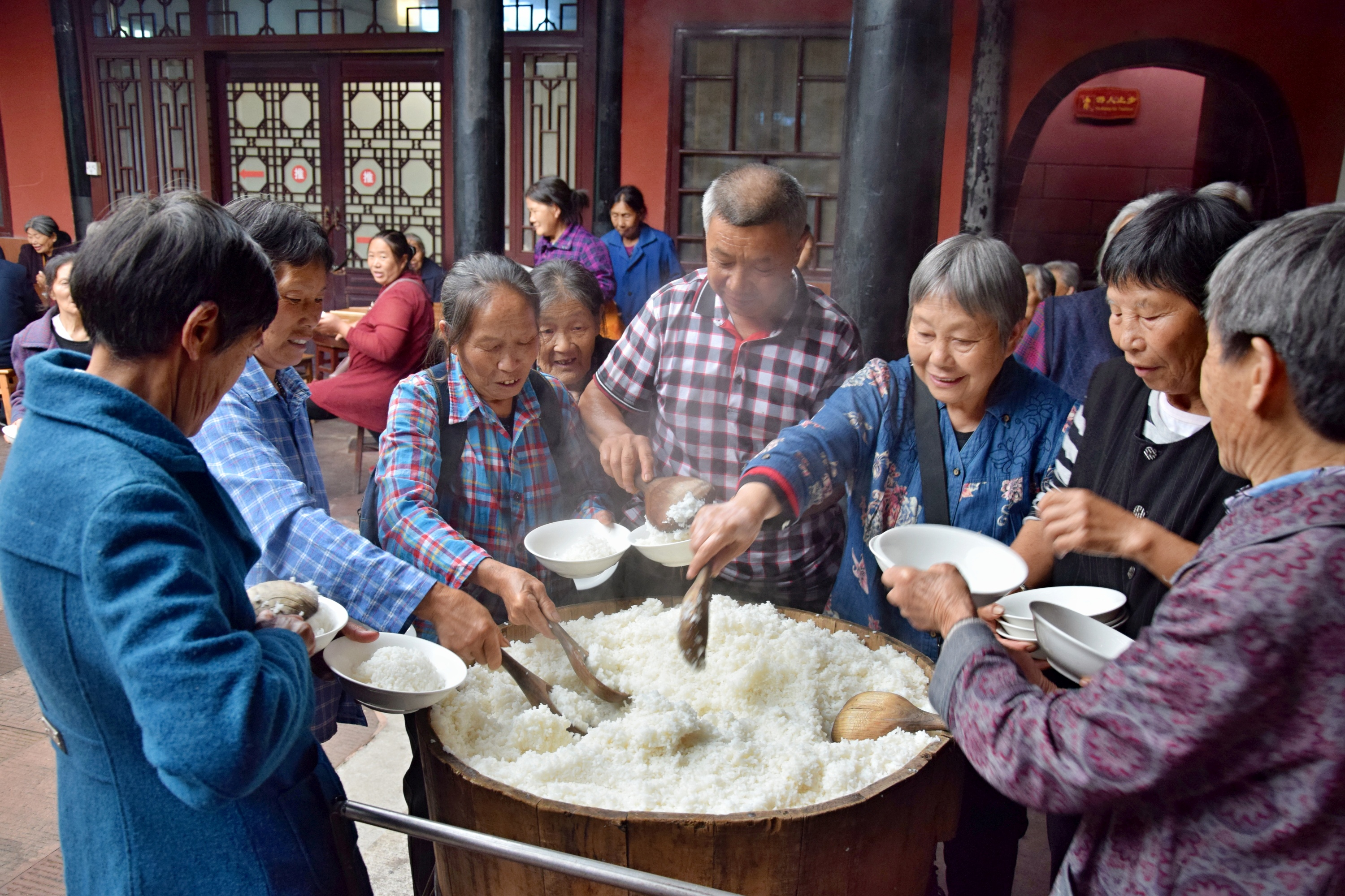 Diners serve themselves rice at a temple restaurant in Sichuan