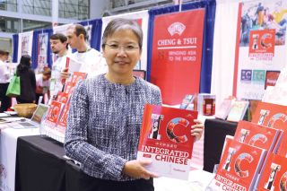 Nyan-Ping Bi displays a copy of Integrated Chinese Volume 1 at ACTFL 2016